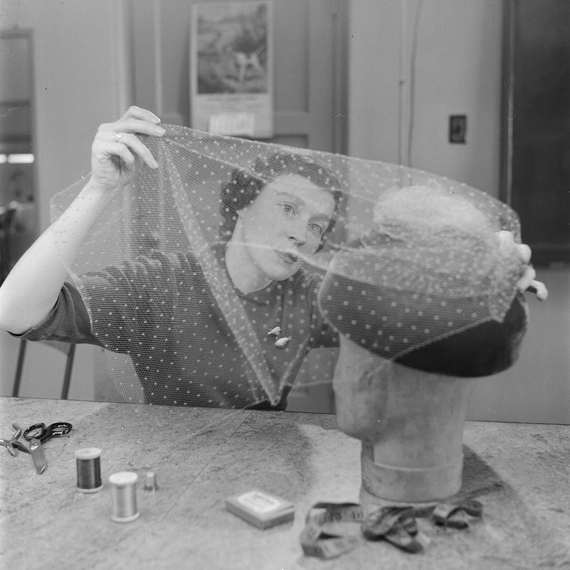Woman at millinery school working on a hat