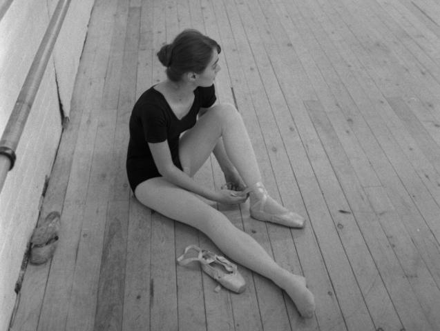 Ballet dancer sitting on floor